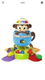 Bright Starts Hide and spin monkey musical ball baby toy