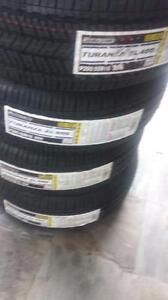 BRIDGESTONE TURANZA EL400 HIGH PERFORMANCE ' H ' RATED ALL SEASON 205 / 55 / 16 TIRE SET OF FOUR.