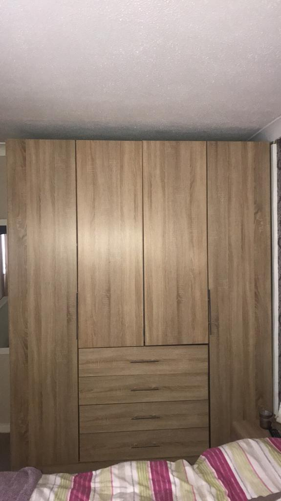 4 door wardrobe with sliding doors and 2 bedside drawers and dressing table  with stool. 4 door wardrobe with sliding doors and 2 bedside drawers and
