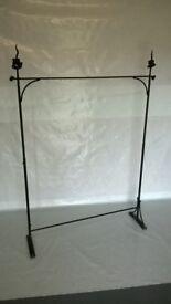 black wrought iron hanger or display