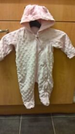 Baby all in one suit age newborn, pink, good condition, pet &smoke free home