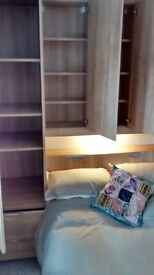 4ft bed with fitted wardrobes and drawers all excellent condition. Can be sold separately.