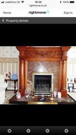 Marble fireplace and hearth and oak surround