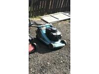 Three lawn mowers