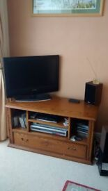 T.V. UNIT IN WOOD. 103cmsx56x46 large drawer and 4 sections. Very good condition. Mid brown wood.