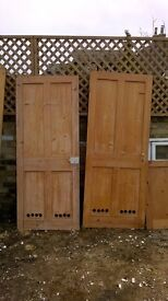 Pine 4 pane l doors with holes at the bottom.