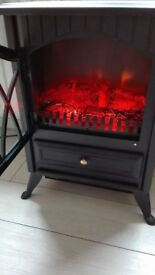 Electric fire, excellent condition, hardly used.
