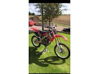 2009 Crf 250r twin pipe might swap for a 2 stroke Cr Yz kx rm banshee 250r raptor etc