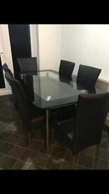 Dining table & chairs Harvey's