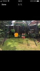 Children's swing and seesaw set.