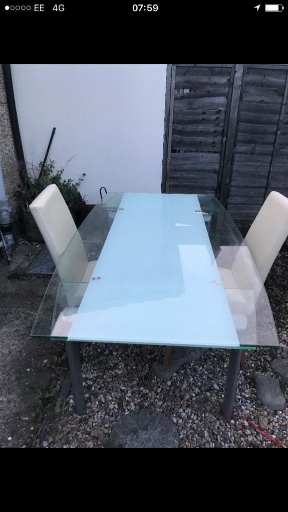 Dining table and four chairsin Bexleyheath, LondonGumtree - Dining table for sale, With four cream chairs. Table extends both ends allowing more places to dine. Collection only