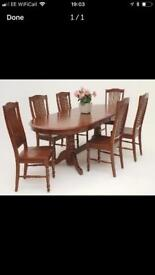 Dark wood extendable dining table & 6 chairs