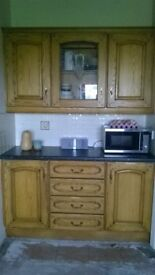 solid oak kitchen with applinces