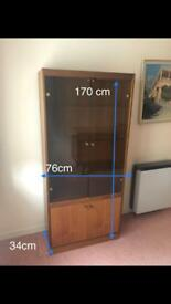 Cabinet with glass and light inside