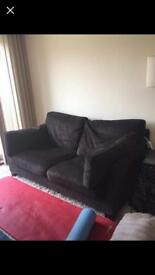 1 black second hand sofa.