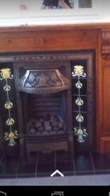 Cast iron coal effect fire and surround