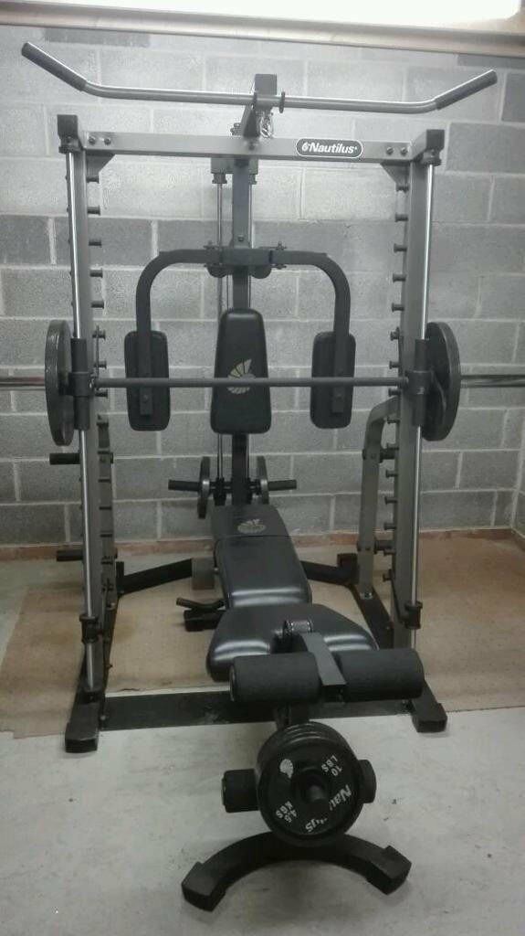 Nautilus smith machine multi gym bench and weight plates