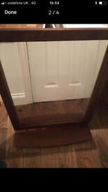 Wooden mirror with aheld