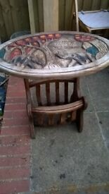 lovely hand carved far eastern table ,has a magazine rack below