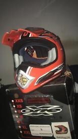 Large Mx helmet red and gold perfect condition never been used with Mx gloves