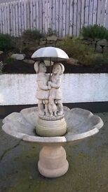 Water Feature - Boy,Girl and dog under Umbrella