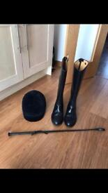 Ladies riding boots, hat and whip