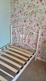 Single cream metal bed