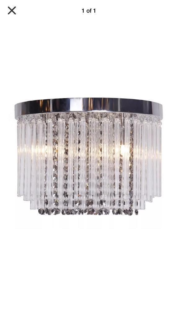 British home stores chandelier with smoke and clear droplets in british home stores chandelier with smoke and clear droplets aloadofball Images