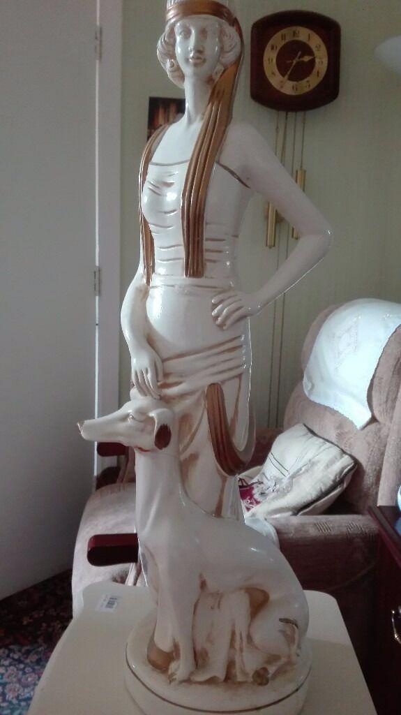 Tall lady with dog figurine