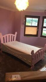 Solid single bed and used mattress