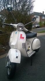 Vespa PX125 in mint condition with only 389 dry miles on the clock.