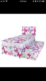 Girls divan bed with trundle.
