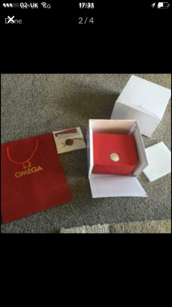 Omega watch box and pspers