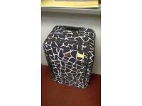 Giraffe print suitcase