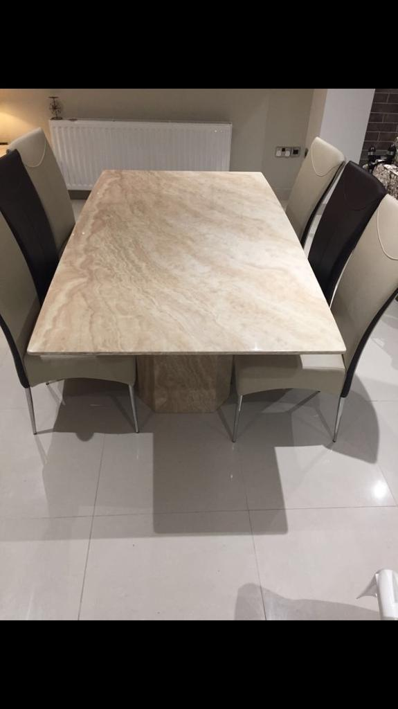 Marble table with 6 chairs all matching