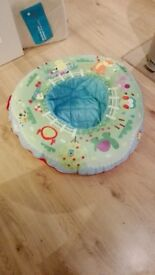 Baby ring, inflatable inner ring with removable and washable cover. Used but in excellent condition.
