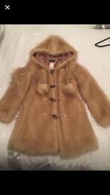 Woman's fur jacket, brand new