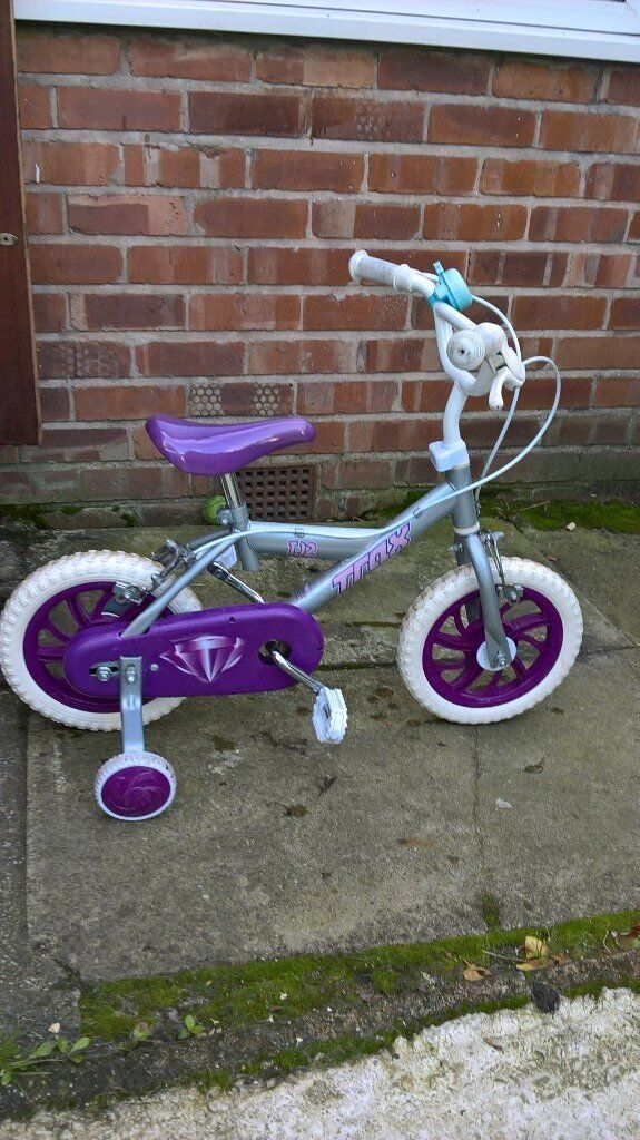 childs purple and white bike for sale, hardly used!!