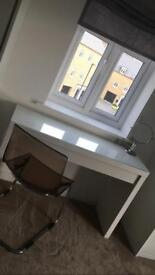 Ikea desk with glass top. Including clear chair