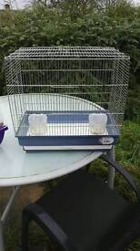 Bird cage with feeders