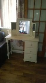 pine dresser and mirror has been painted.