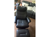 TWO BLACK LEATHER EFFECT RECLINING CHAIRS