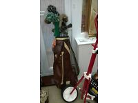 Set of golf clubs including bag and trolley