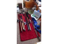 A large selection of fishing rods, reels etc