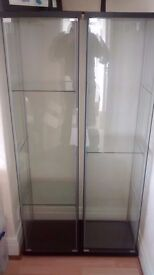3 Detolf glass cabinets from IKEA.