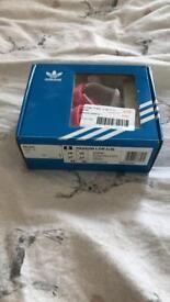 Girls pink adidas crib shoes