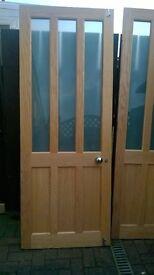two wooden doors glass panels