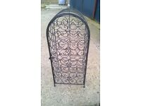 Black wrought iron wine rack
