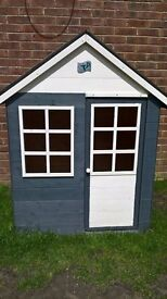 Tp wooden playhouse.