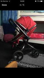 A nice Red colour pram in good condition